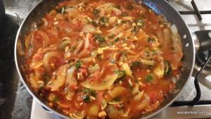 Prepare the onions and tomato.