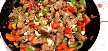 Greek-style Fried Pork Bites with Peppers and Feta Cheese