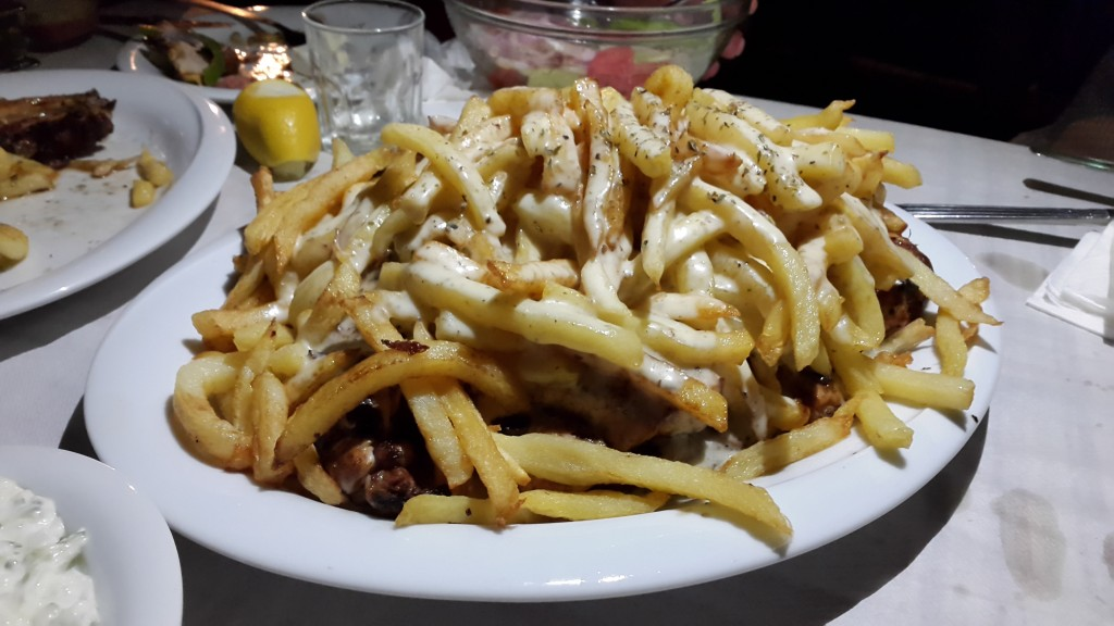 Grilled chicken with chips and mustard sauce from a local tavern